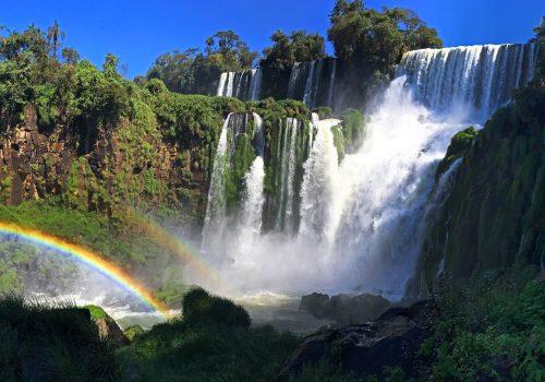 A series of waterfalls making rainbows.